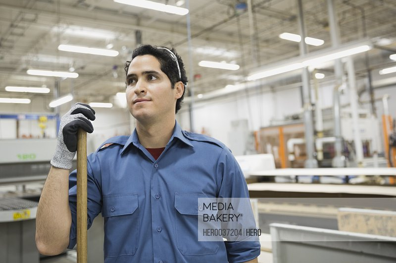 Thoughtful worker in manufacturing plant