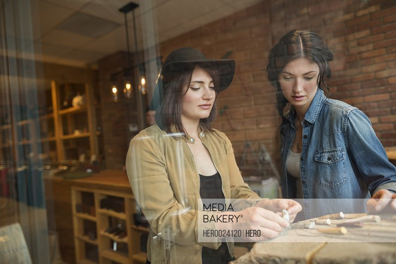 Women browsing jewelry in shop