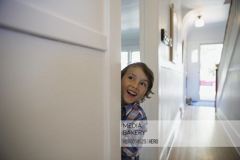 Excited boy in doorway