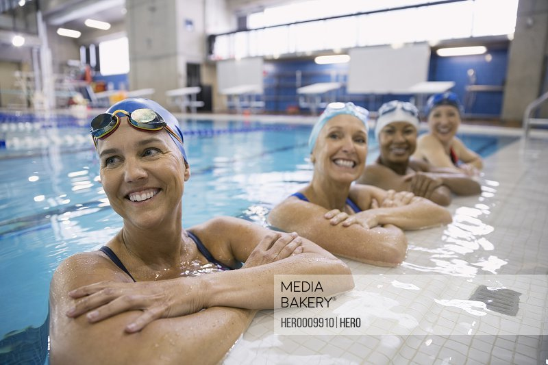 Smiling women in swimming pool