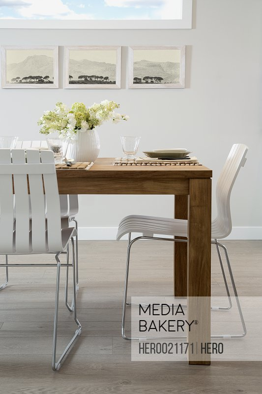 White chairs at wooden dining table