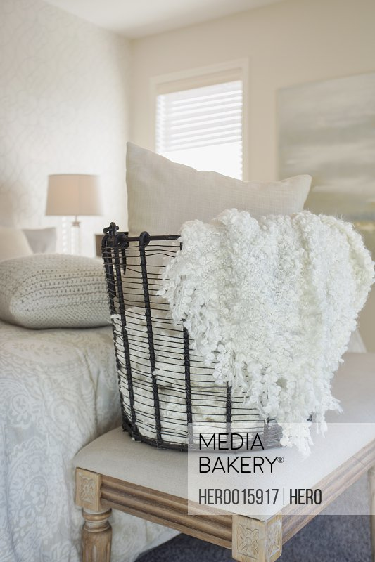 Pillow and blanket in wire bedroom basket