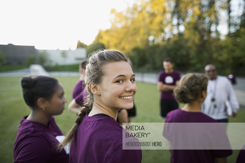 Portrait smiling female high school student physical education