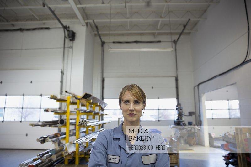Portrait confident worker in factory