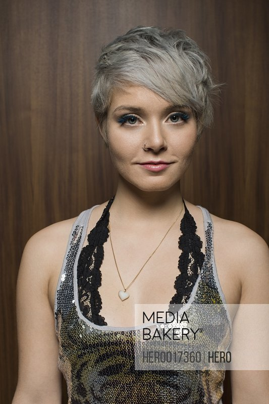 Portrait of confident stylish woman with short hair