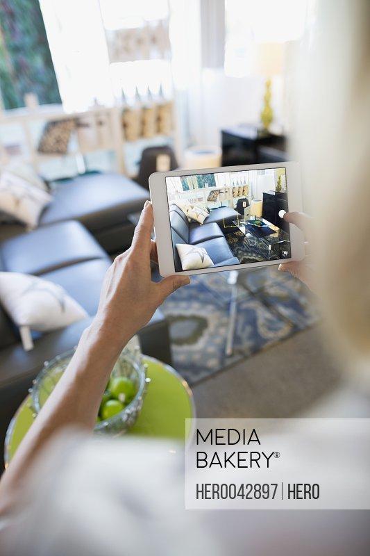 Woman using digital tablet camera in home furnishings store
