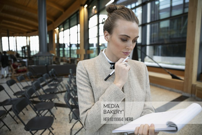 Focused businesswoman preparing for presentation