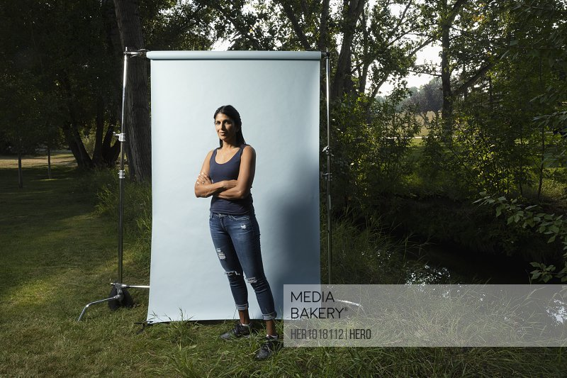 Portrait confident woman against white screen in park