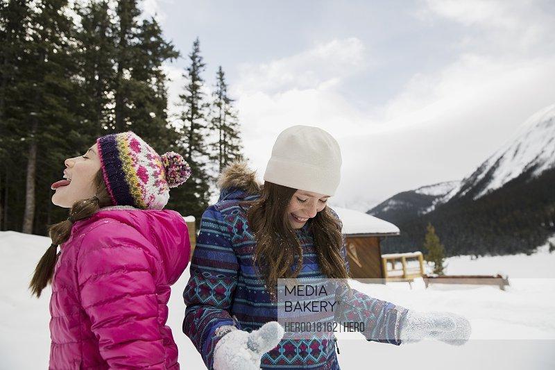 Playful girls in snowy field