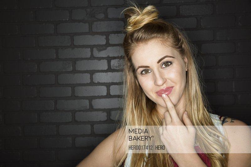 Portrait of pensive blonde woman with hair bun