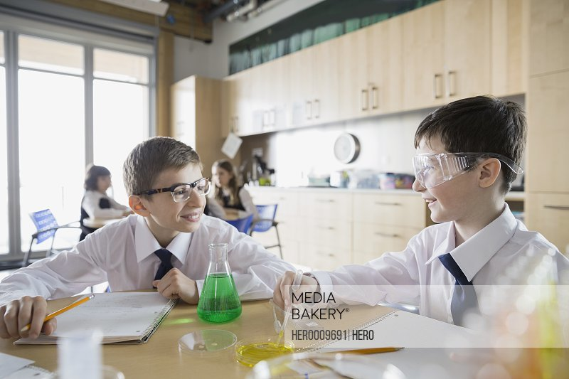School boys conducting experiment in science classroom