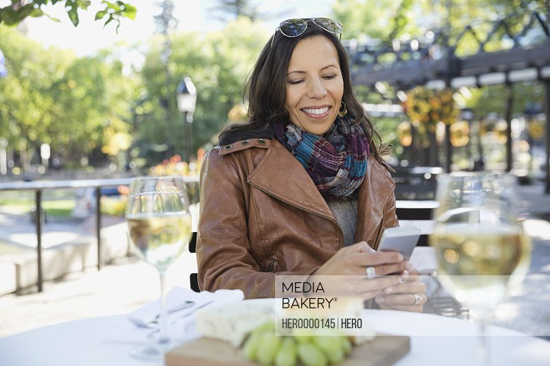 Woman using smart phone outdoors