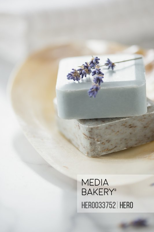 Close-up of guest soaps in soap dish with lavender sprig