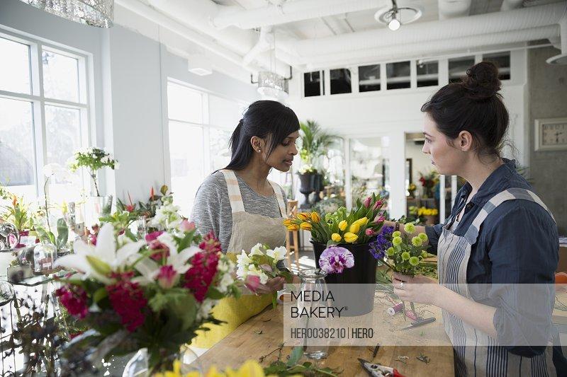 Florists arranging flowers in flower shop