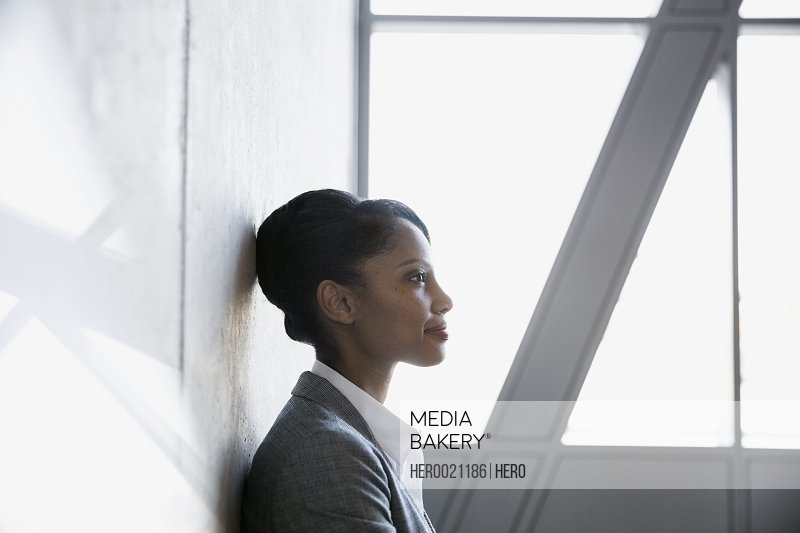 Profile pensive businesswoman with black hair looking away