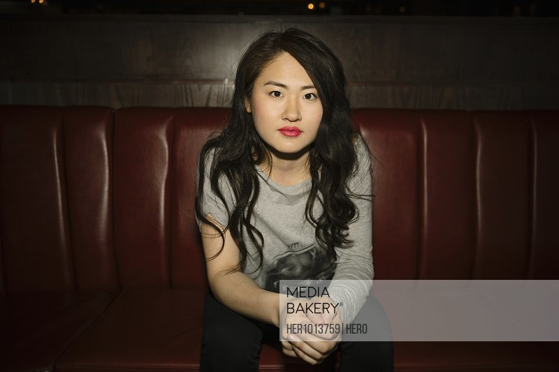 Portrait confident, cool female millennial in nightclub