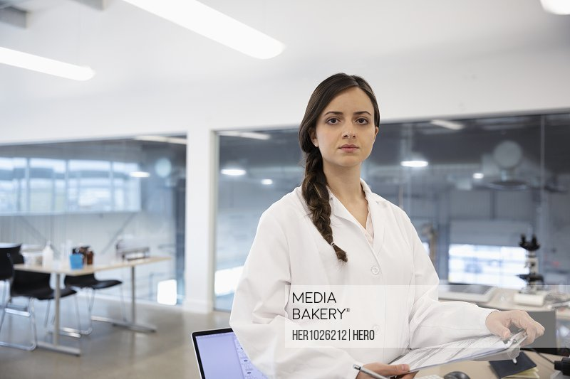 Portrait confident female scientist in laboratory