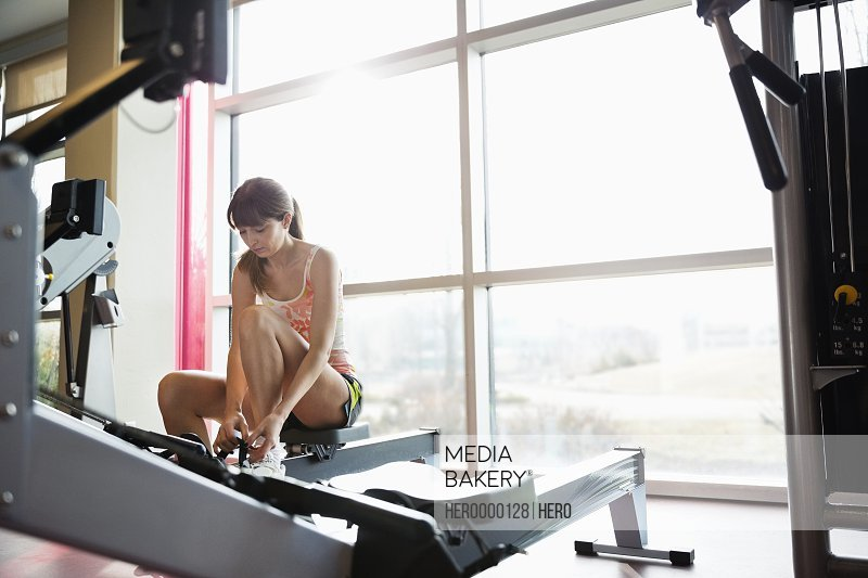 Woman preparing to exercise in fitness center