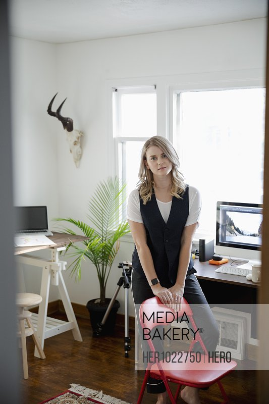 Portrait confident woman working in home office