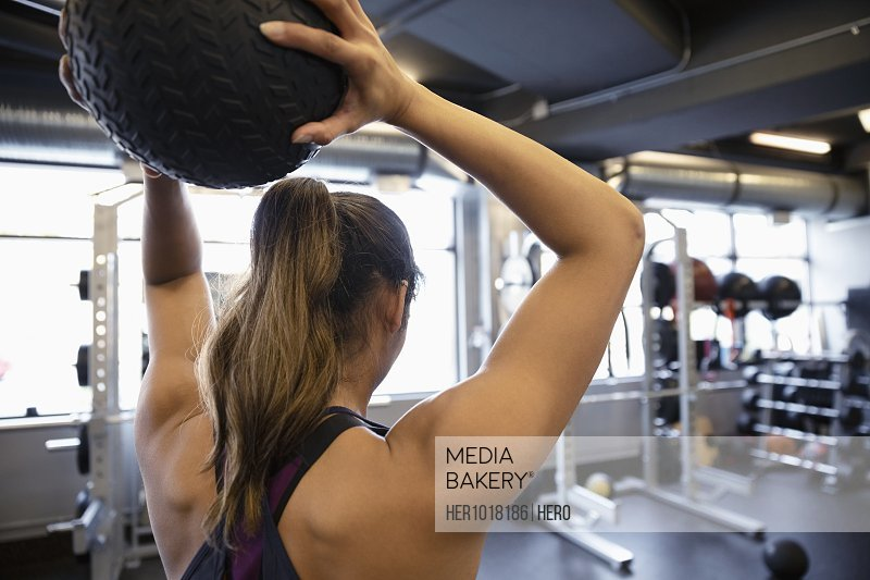 Woman exercising with medicine ball in gym