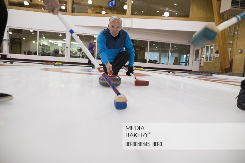 Senior man curling