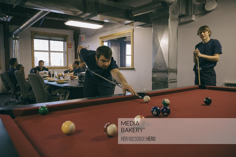 Firefighters playing pool in fire station