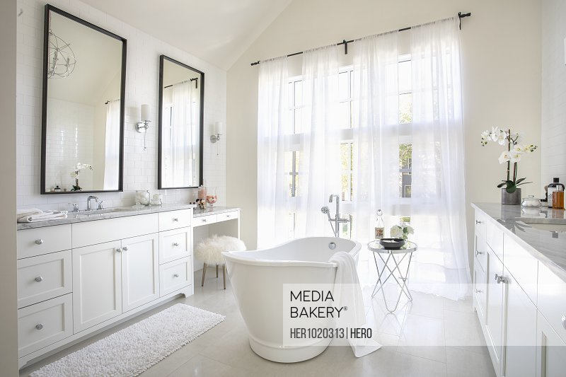 White home showcase interior bathroom with soaking tub