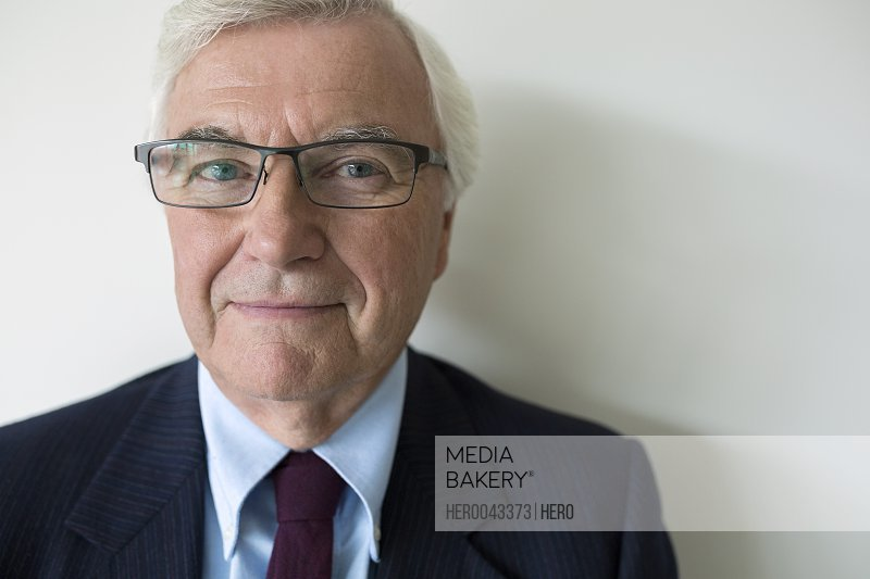 Close up portrait senior businessman with eyeglasses