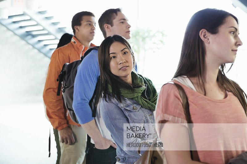 Group of students standing in line at college campus