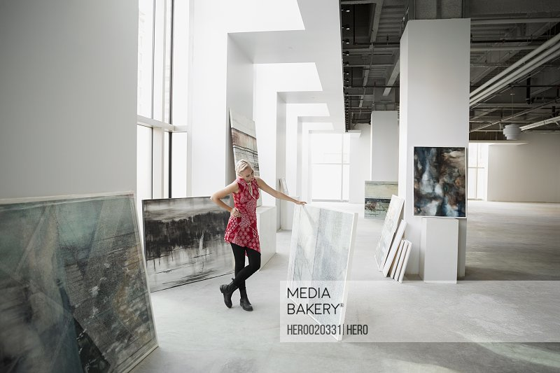 Art dealer viewing painting in art gallery