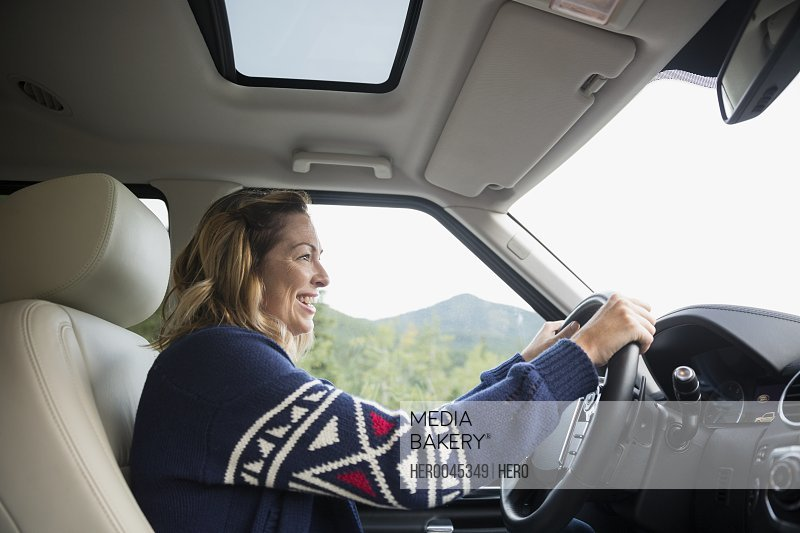 Smiling woman driving SUV