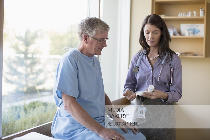 female doctor advising senior patient on medications