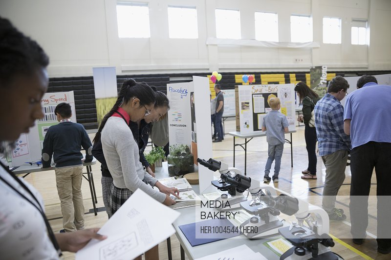 Middle school students and parents viewing science projects at science fair