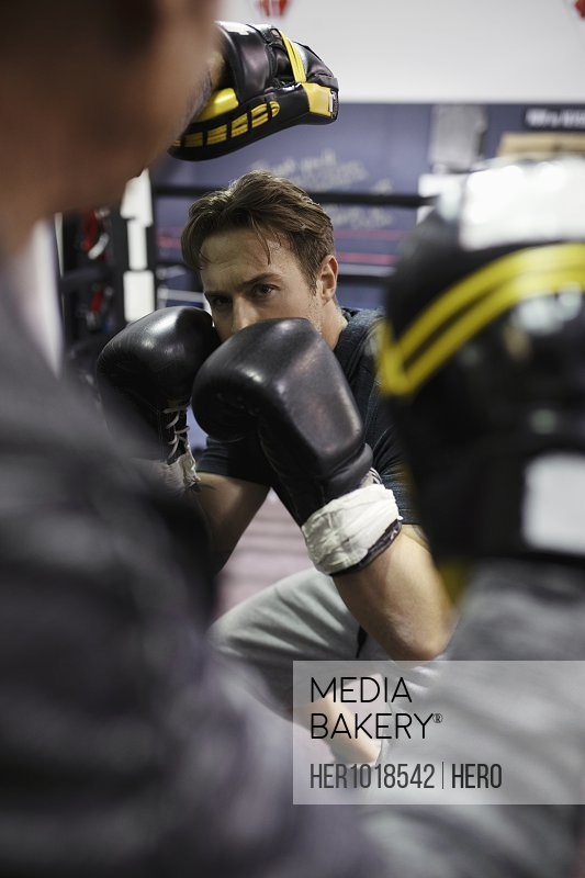 Focused male boxer training in gym