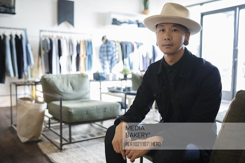 Portrait confident male business owner in menswear clothing shop