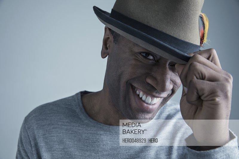 Portrait smiling African American man wearing fedora