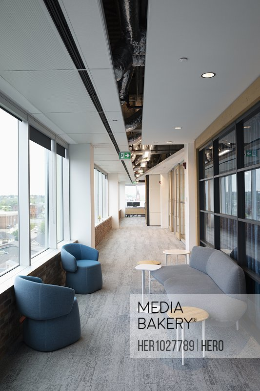 Modern coworking space corridor with seating area
