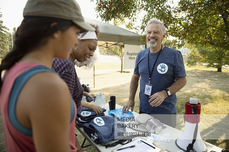 Volunteers checking in at table in park