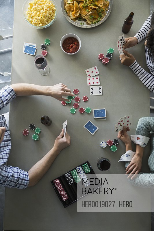 Overhead view of friends playing poker