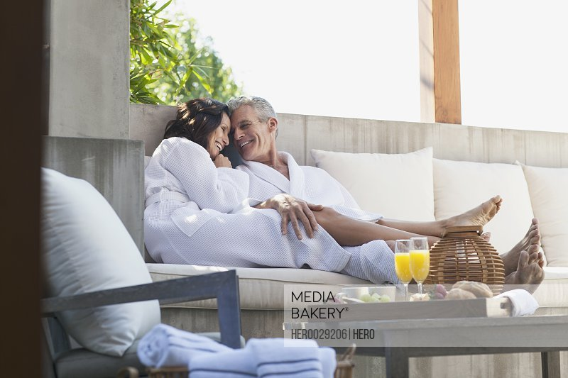 couple cuddling on outdoor patio