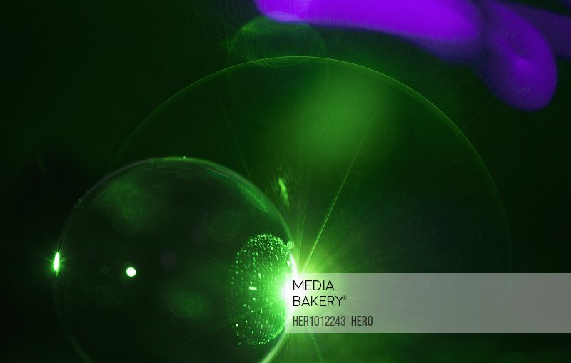 Creative abstract green sphere eclipse
