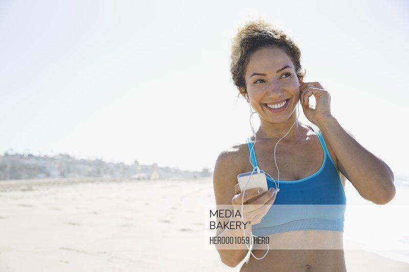 Active woman enjoying music during workout