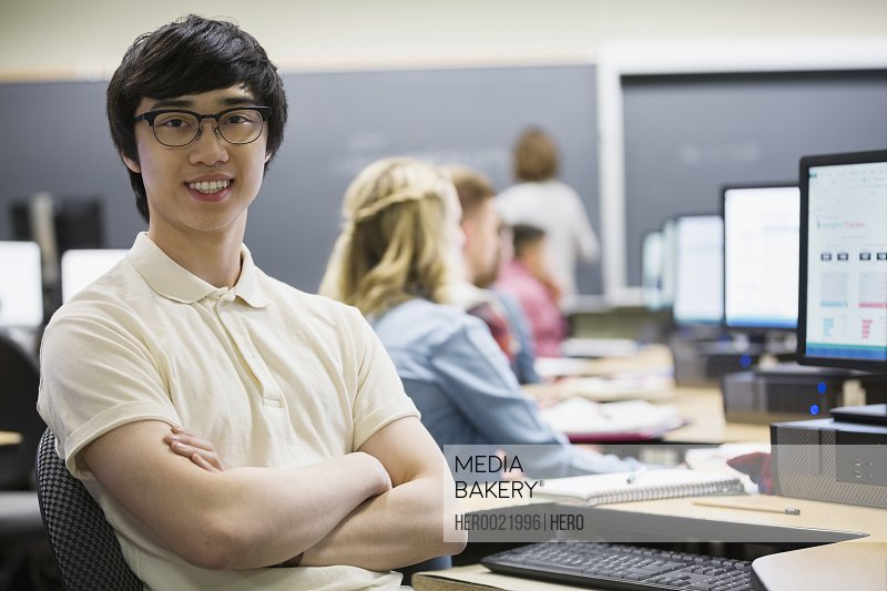 Portrait confident college student in computer lab classroom