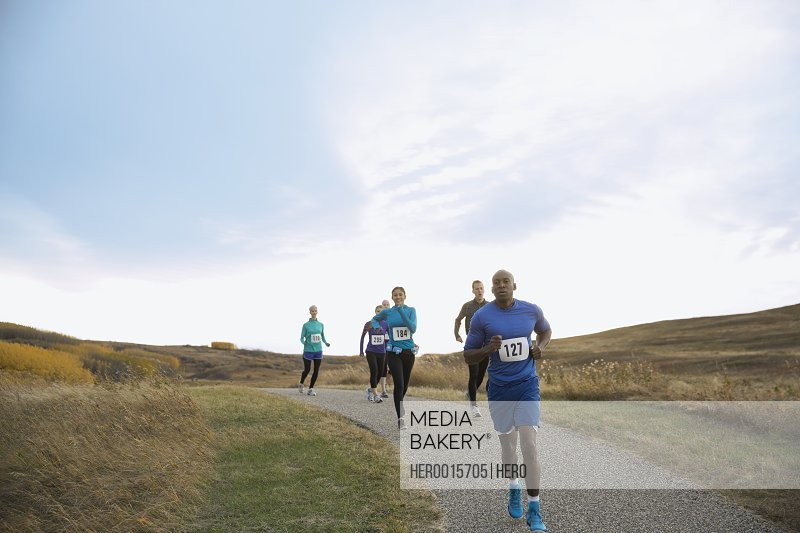 Runners racing on rural path