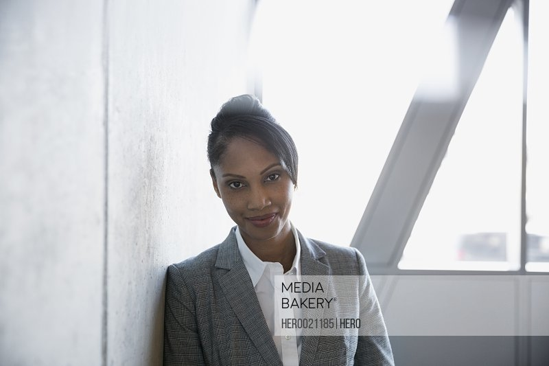 Portrait confident businesswoman with black hair