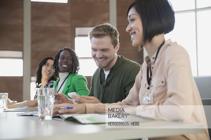 Businesspeople smiling in classroom