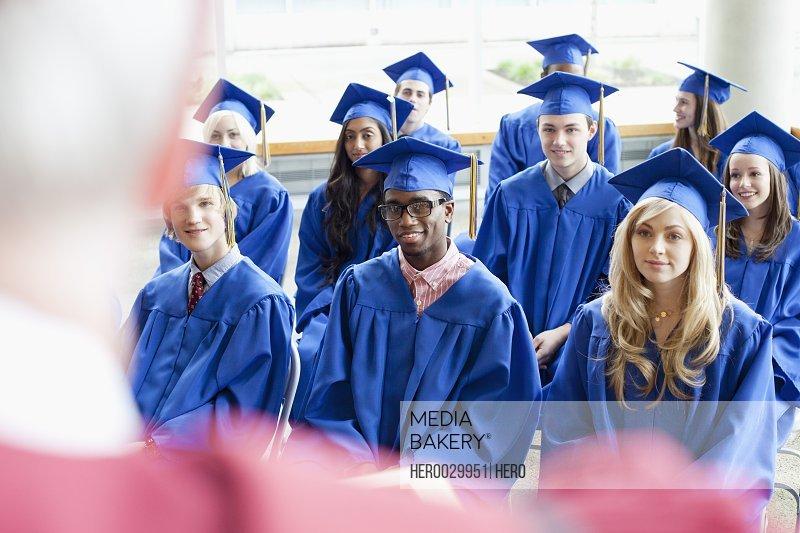 graduates listening to speaker during grad ceremony