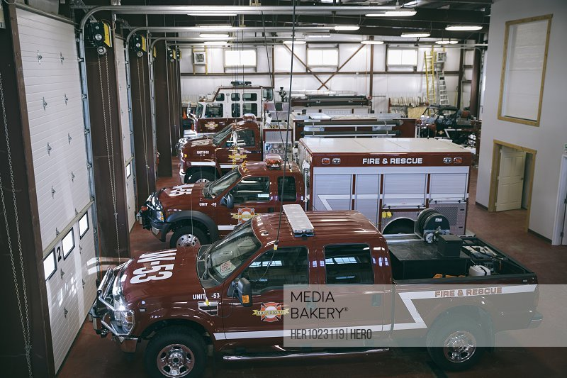 Fire engines and trucks parked inside fire station
