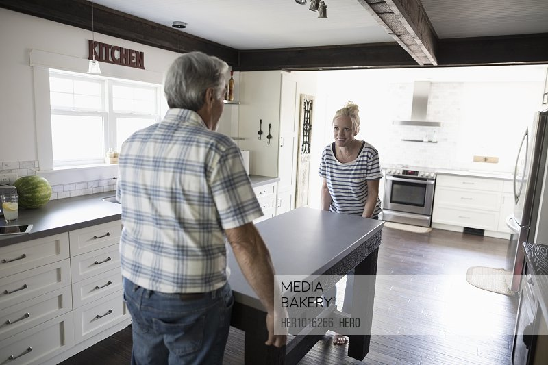 Father And Daughter Moving Kitchen Island