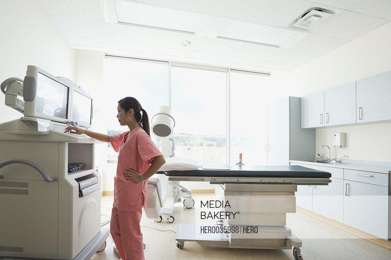 Female radiology attendant programming equipment